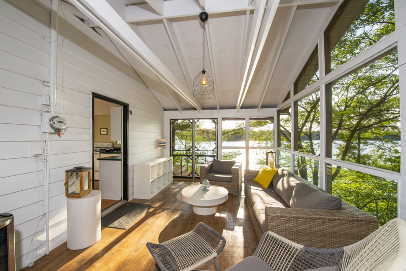 3978 East Shore Road Muskoka room interior with views of Gloucester Pool